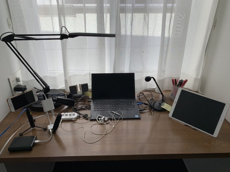 remote interpreting setting with PC, iPad and iPhone with microphones and LAN cables connected